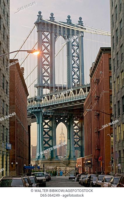 Evening view of Manhattan bridge and Empire State Building from Washington street. Manhattan. New York city. USA