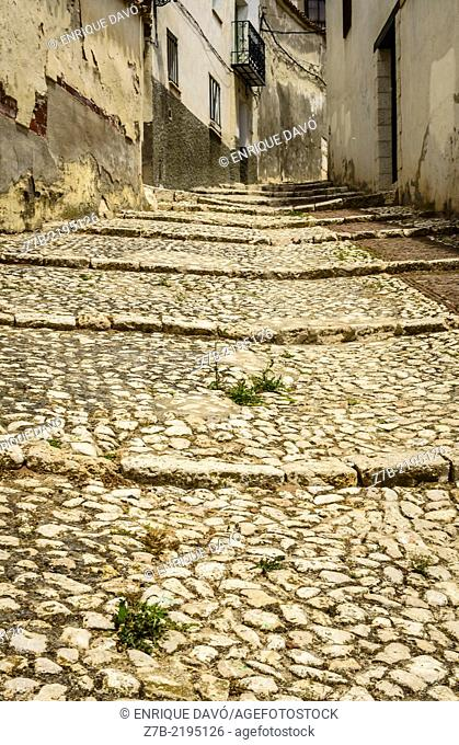 Down view of a street with stones in Chinchon village, Madrid province, Spain