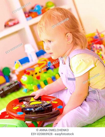Baby girl in playing room