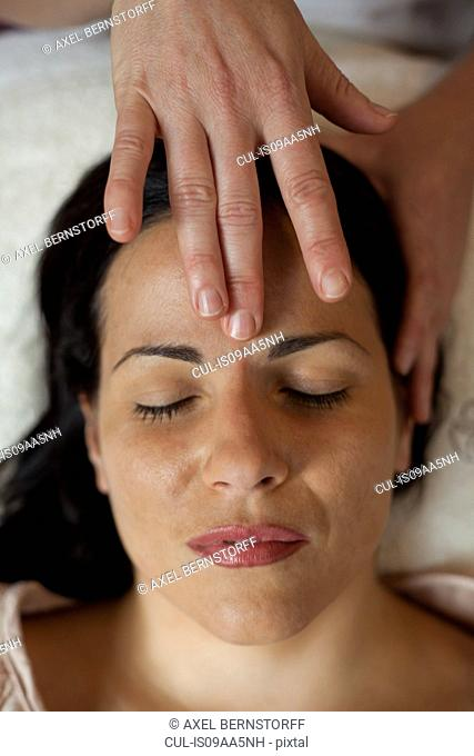 Woman having facial treatment