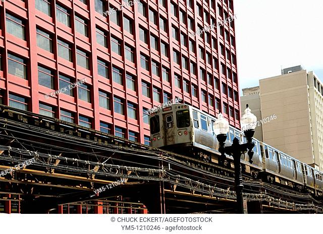 Chicago public transportation train the 'EL' or L rusjing down tracks in the Loop area
