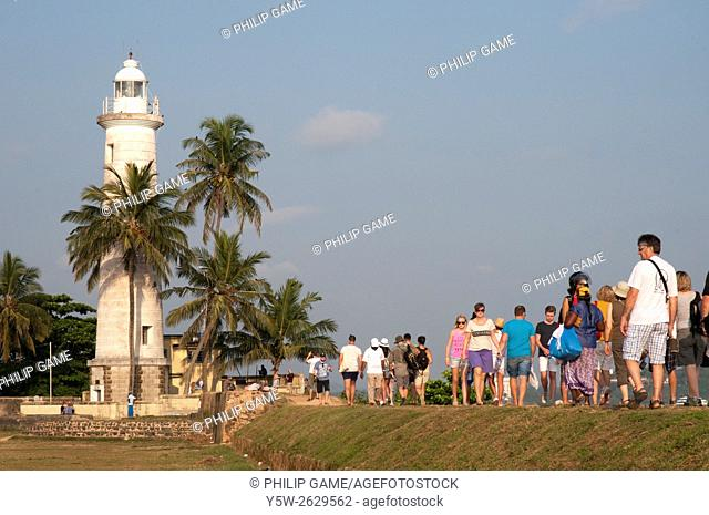 Tourists join the evening promenade along the ramparts of Galle Fort, Sri Lanka