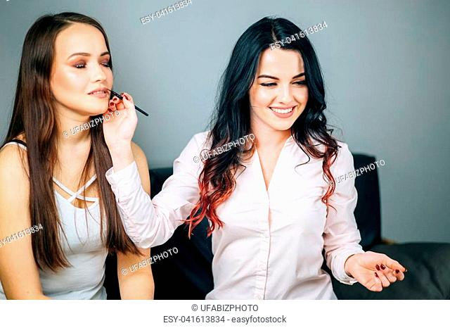 blogging, technology, videoblog, makeup and people concept - happy smiling woman or beauty blogger doing makeup from her client