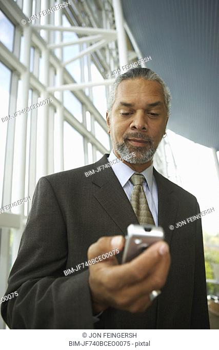 African businessman with cell phone, North Bethesda, Maryland, United States