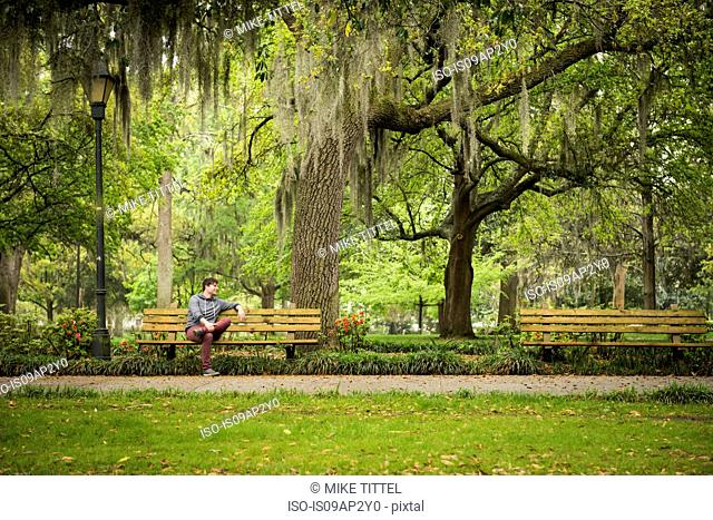 Man on park bench, Savannah, Georgia, USA