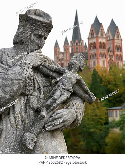 A stone statue of John of Nepomuk stands on the old Lahn Bridge near Limburg Cathedral in Limburg, Germany, 21 October 2013