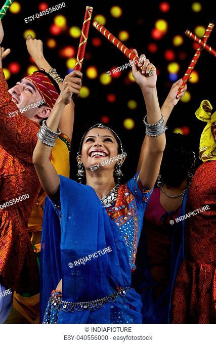People performing dandiya