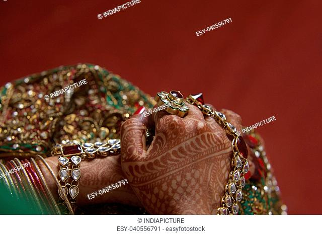 Close-up of woman's hand covered with henna
