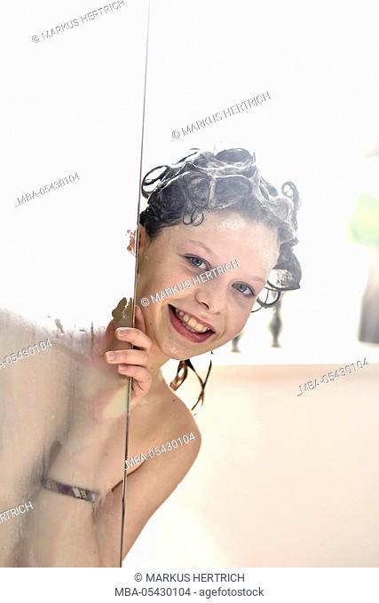 Girl, 10 years showering, washing hair, shampoo
