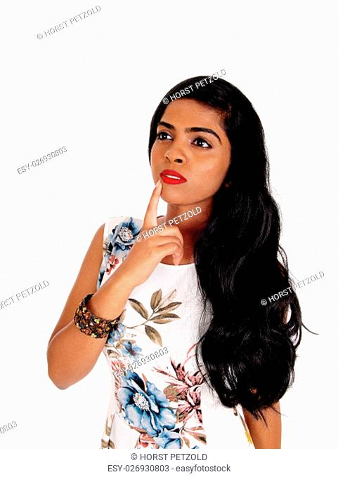 A portrait image of a lovely young Indian woman with long black hair,.with one finger on face, isolated for white background.