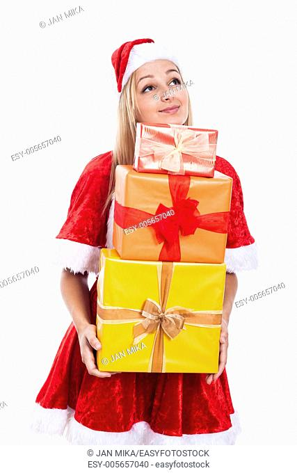 Thankful Christmas woman holding many presents and looking up, isolated on white background