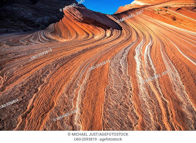 Sandstone erosion has produced highly textured parallel lines and groves in the landscape at Sand Cove at Coyote Buttes, Arizona