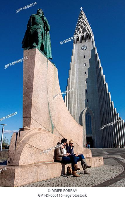 TOURISTS RELAXING AT THE FOOT OF THE STATUE OF THE VIKING LEIF ERICKSON, FIRST EUROPEAN TO HAVE STEPPED FOOT IN NoRTH AMERICA