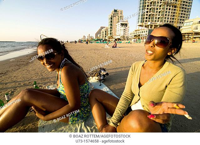 Ethiopian beauties sunbathing at Tel-Aviv's beach