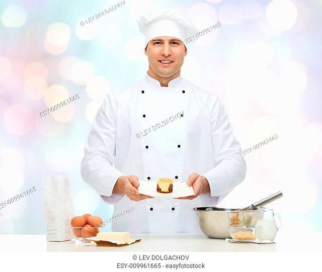 cooking, profession, haute cuisine, food and people concept - happy male chef cook baking dessert over blue lights background