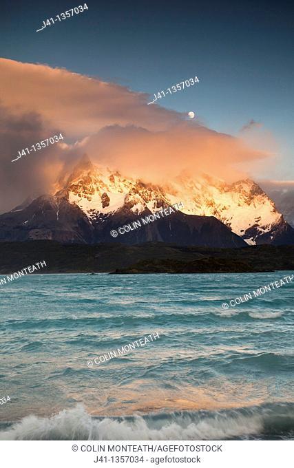 Paine Grande at dawn, near full moon, Lago Pehoe, Parque Nacional Torres del Paine, Patagonia, Chile