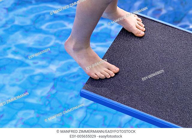 Bather just before take-off from the diving board into the pool