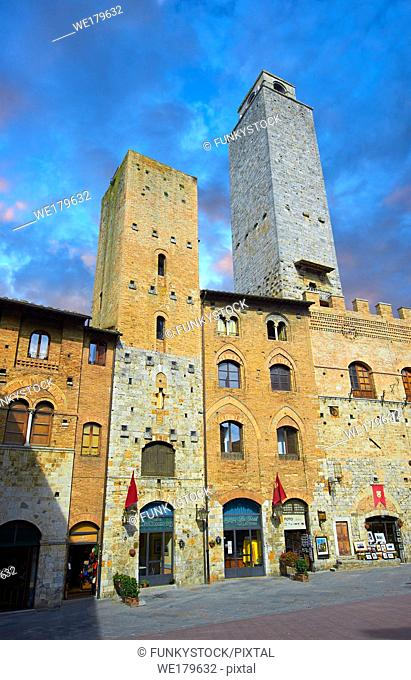 The Piazza Duomo (Cathedral Square) of San Gimignano with its medieval towers built as defensive towers and also to show the families wealth by the height of...