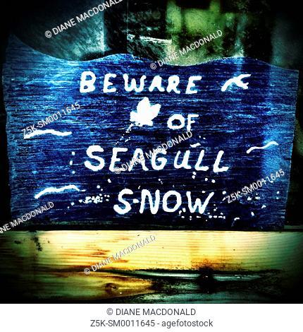 Humorous sign on Jacksonville Beach Pier, Jacksonville Beach, Florida, USA