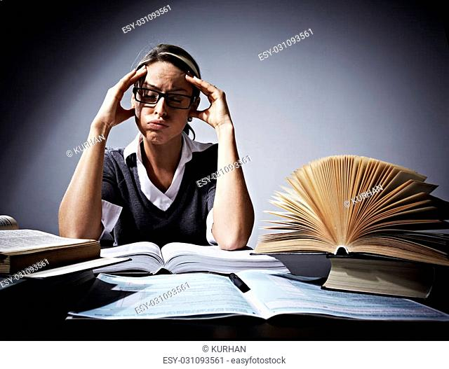 Young student woman with books. Conceptual background