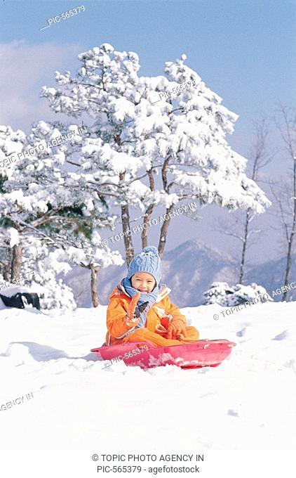 A Girl Sledding In Snow,Korean