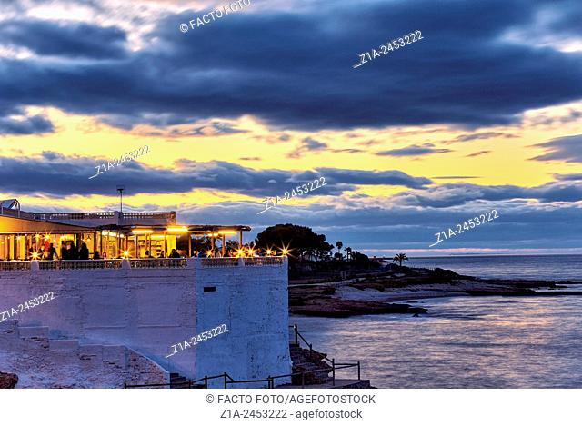 "Beach bar by sunset at """"Las Rotas"""" beach. Denia. Alicante. Valencia Community. Spain"