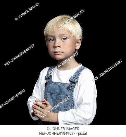 Portrait of boy on black background