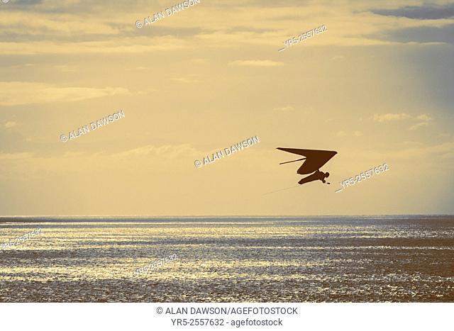 Las Palmas, Gran Canaria, Canary Islands, Spain. Hang Glider flying over Atlantic Ocean near take off point in Las Palmas