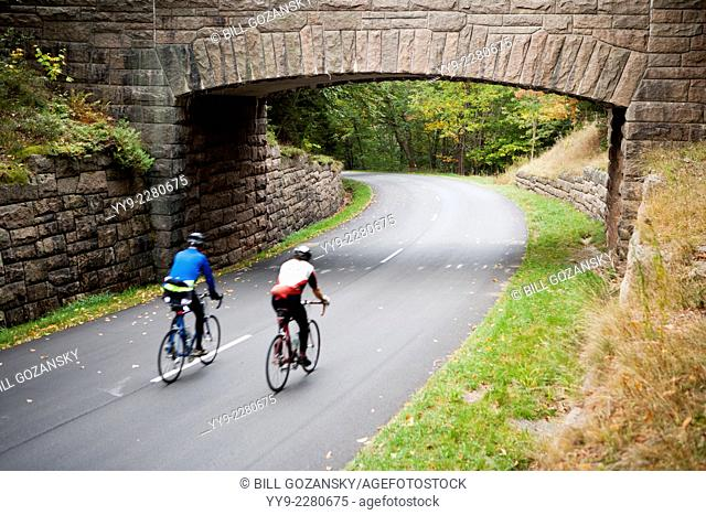 Cyclists and Stone Bridge - Acadia National Park - Bar Harbor, Maine USA