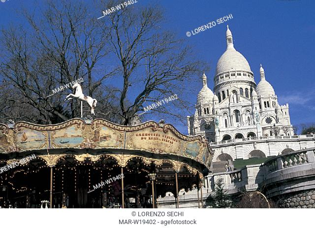 france, paris, montmartre, basilica of sacre-coeur and the merry-go-round