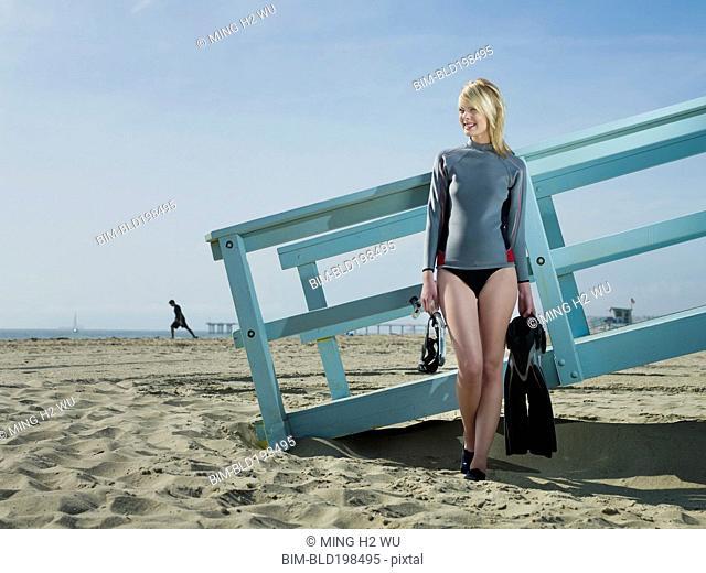Caucasian lifeguard standing at lifeguard station