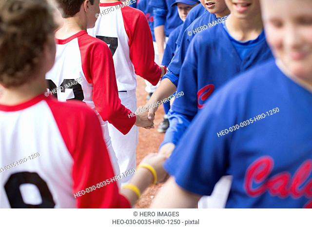 boys baseball teams shaking hands after game
