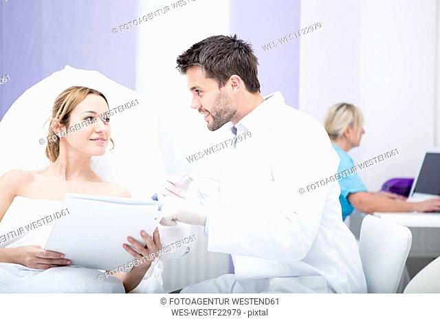 Aesthetic surgery, doctor talking to woman