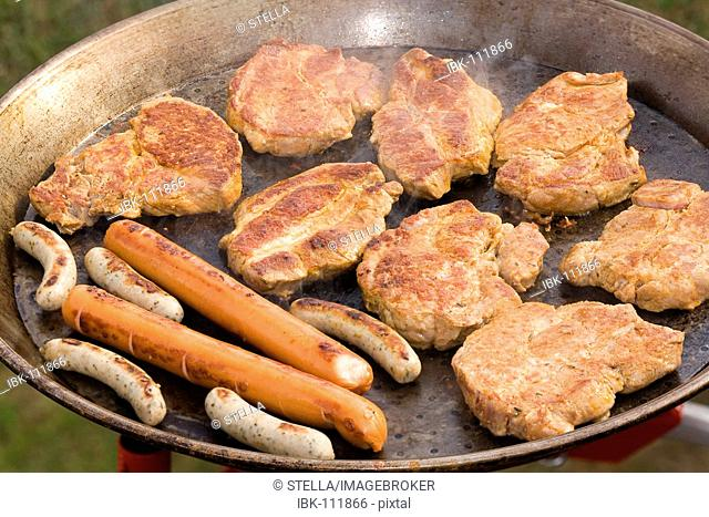 Grilled steaks and sausages
