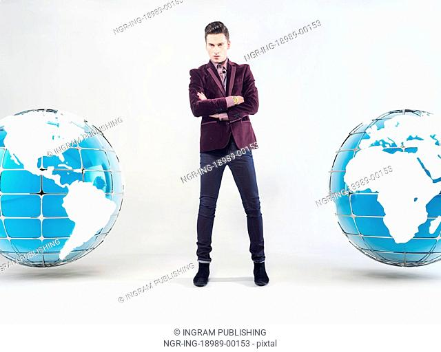 Young handsome businessman and Earth globe