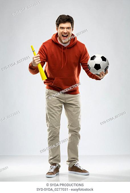 man or football fan with soccer ball and vuvuzela