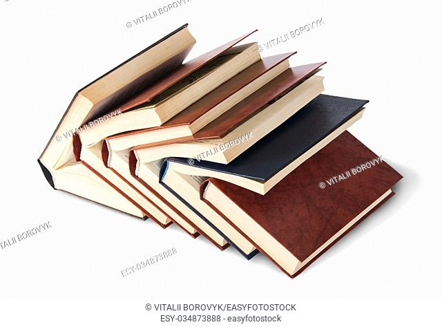 Six old books imbedded in one another top and front view isolated on white background