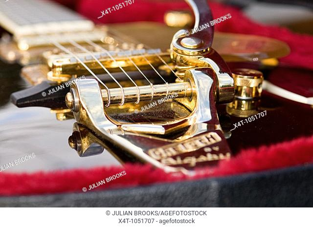How the strings are attached on an electric guitar Gretsch detail with limited depth of focus