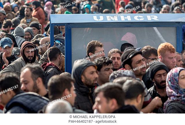 Refugees stand at the border between Greece and Macedonia at the refugee camp Idomeni, Greece, 04 March 2016. The situation at border has worsened after heavy...