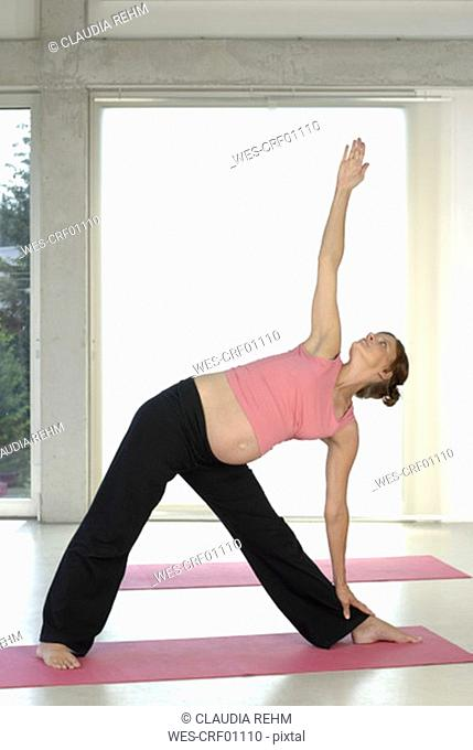 Pregnant woman execising yoga