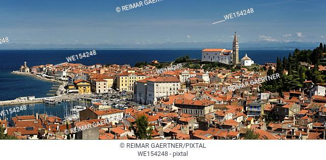 Panorama of Piran Slovenia on Gulf of Trieste Adriatic sea from the Cape Madonna St Clement church to St George's Cathedral with Kanin Mountains