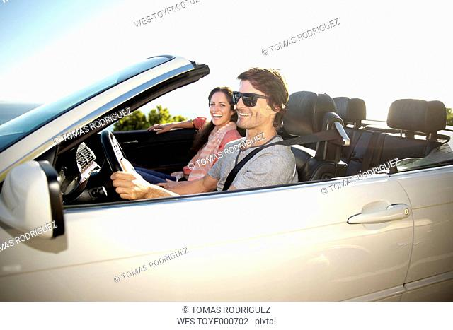 South Africa, happy couple in convertible