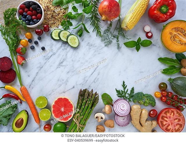 Healthy food vegetables for heart heath on white marble background