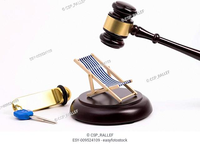 Wooden gavel key and deck chair