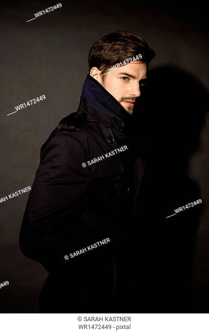 Portrait of a man wearing coat