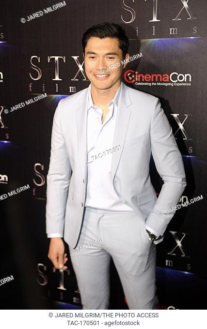 "Actor Henry Golding arrives at the STXfilms presentation red carpet for CinemaCon's """"The State Of The Industry: Past, Present and Future"""" at The Colosseum at..."