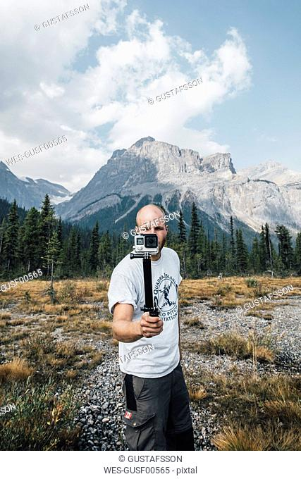 Canada, British Columbia, Yoho National Park, man holding selfie stick