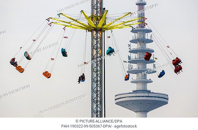 22 March 2019, Hamburg: A high carousel rotates on Hamburg's Spring Cathedral. The Spring Cathedral will take place from 22 March to 22 April 2019