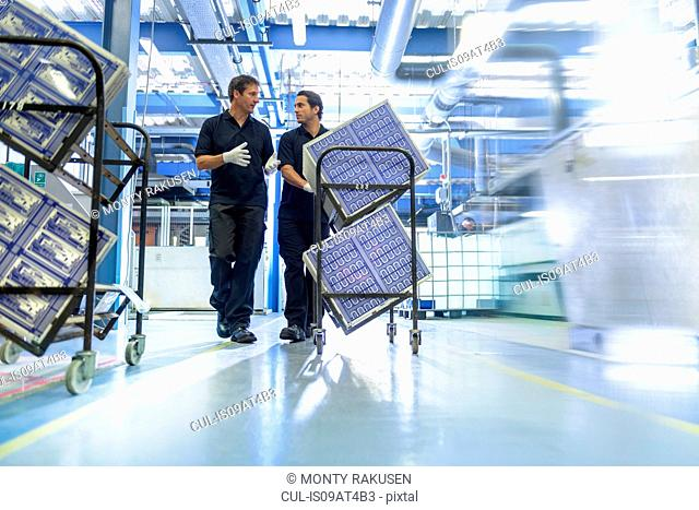 Workers in circuit board manufacturing factory