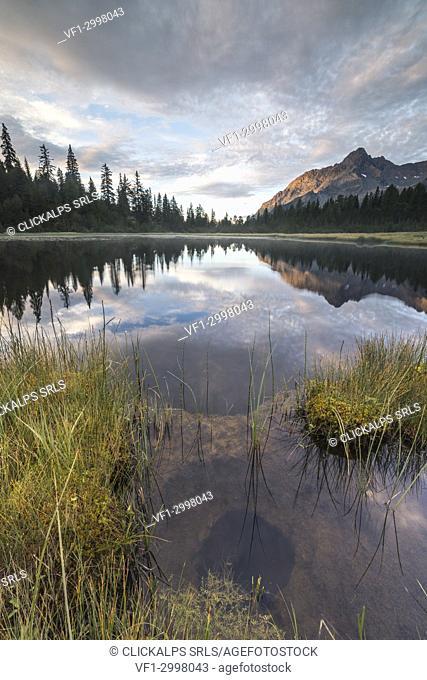 Clouds on Lake Entova at dawn, Entova Alp, Malenco Valley, Sondrio province, Valtellina, Lombardy, Italy